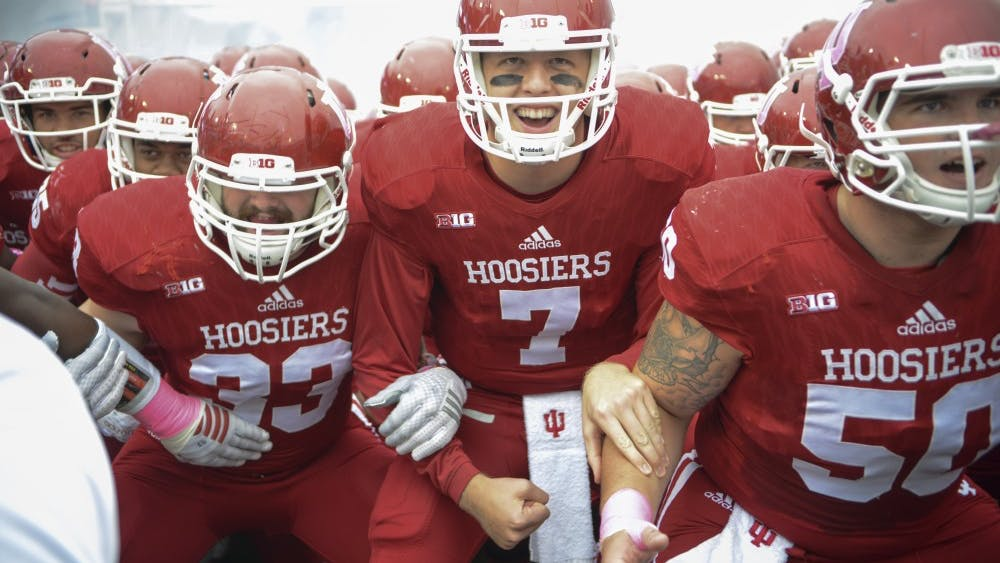 The team gets pumped up by coach Mark Hill before the game against Ohio State on Saturday at Memorial Stadium. The Hoosiers lost to the number one ranked Buckeyes, 27-34.