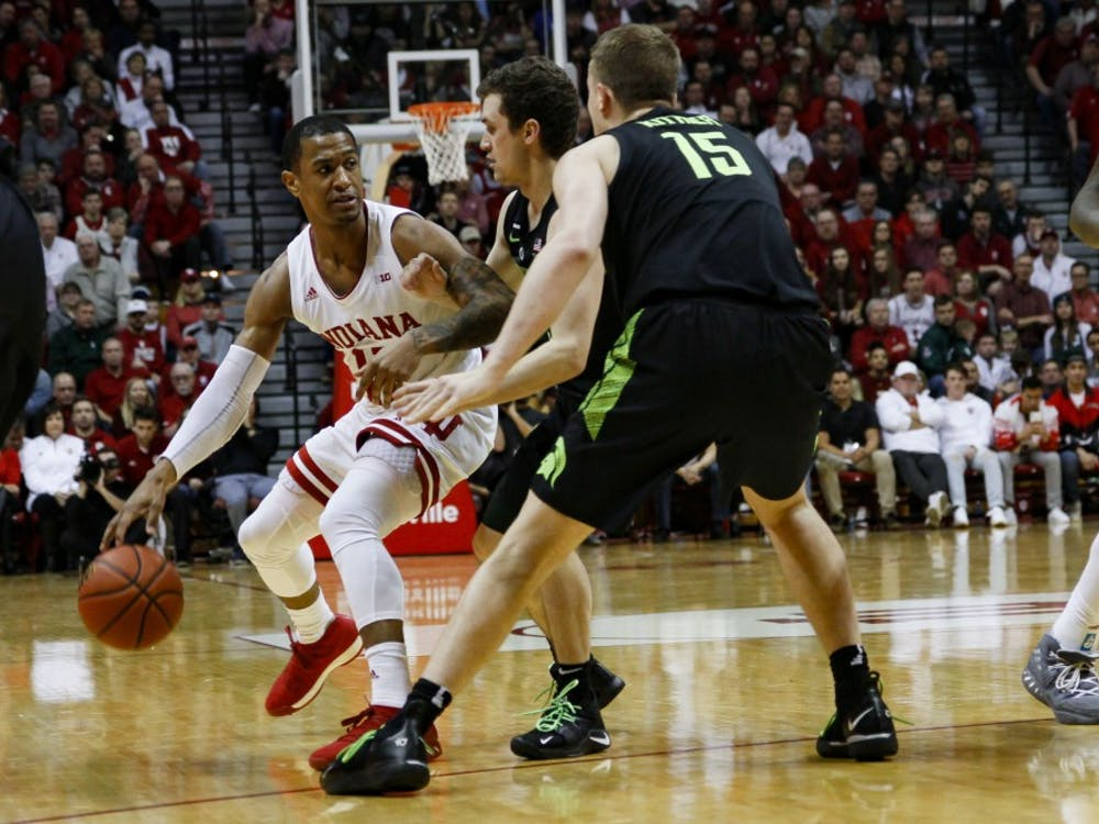 Junior guard Devonte Green defends the ball against Michigan State on March 2 at Simon Skjodt Assembly Hall. Green scored 13 of the 63 points scored.