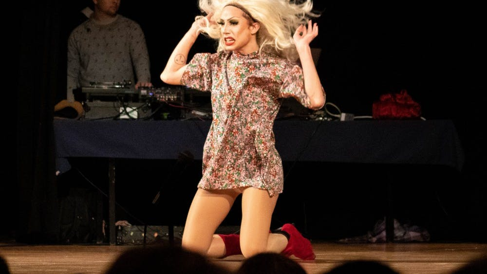 """Merle poses on stage during """"Life's a Drag(race)"""" show on Feb. 8 at Alumni Hall. The performers danced and lip-synced their way to winning."""