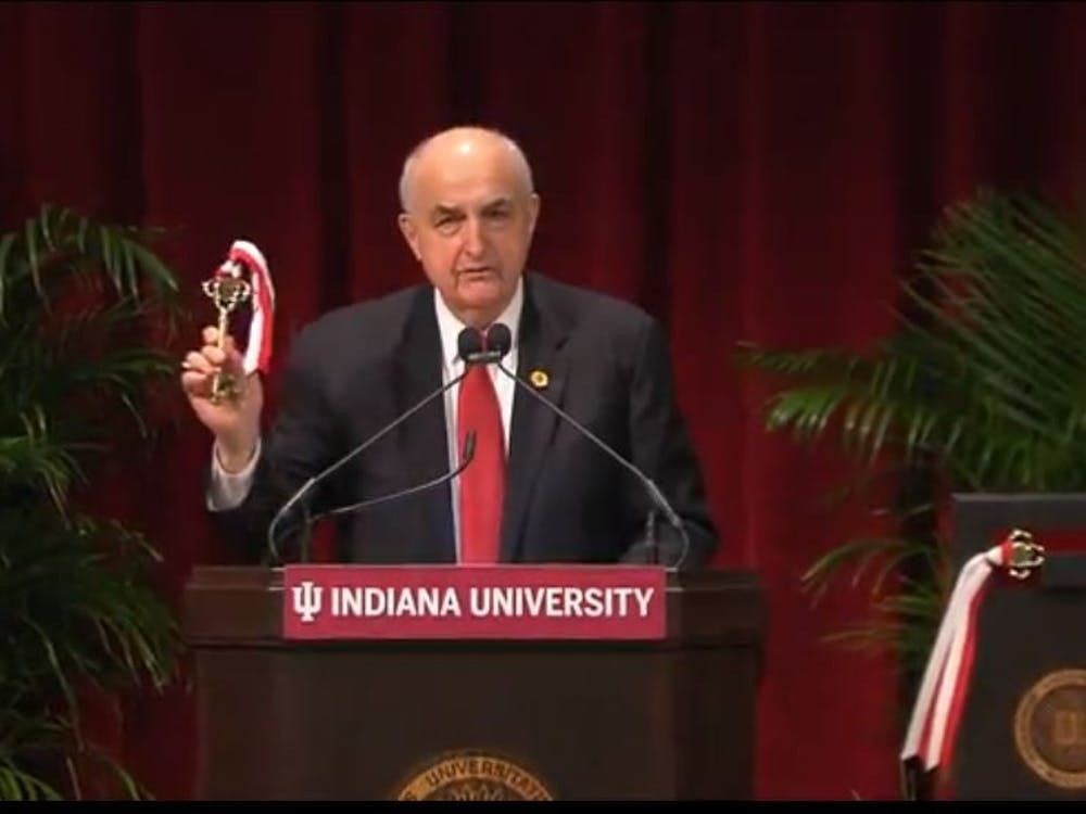 IU president Michael McRobbie holds up a symbolic key at a dedication event Wednesday. The event was McRobbie's final public event as IU's president.