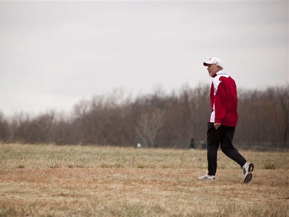 IU Director and Head Coach of Men's and Women's Track and Field and Cross Country Ron Helmer walks toward the course before the start of the men's NCAA Cross Country Championship race on Nov. 22, 2010, in Terre Haute.