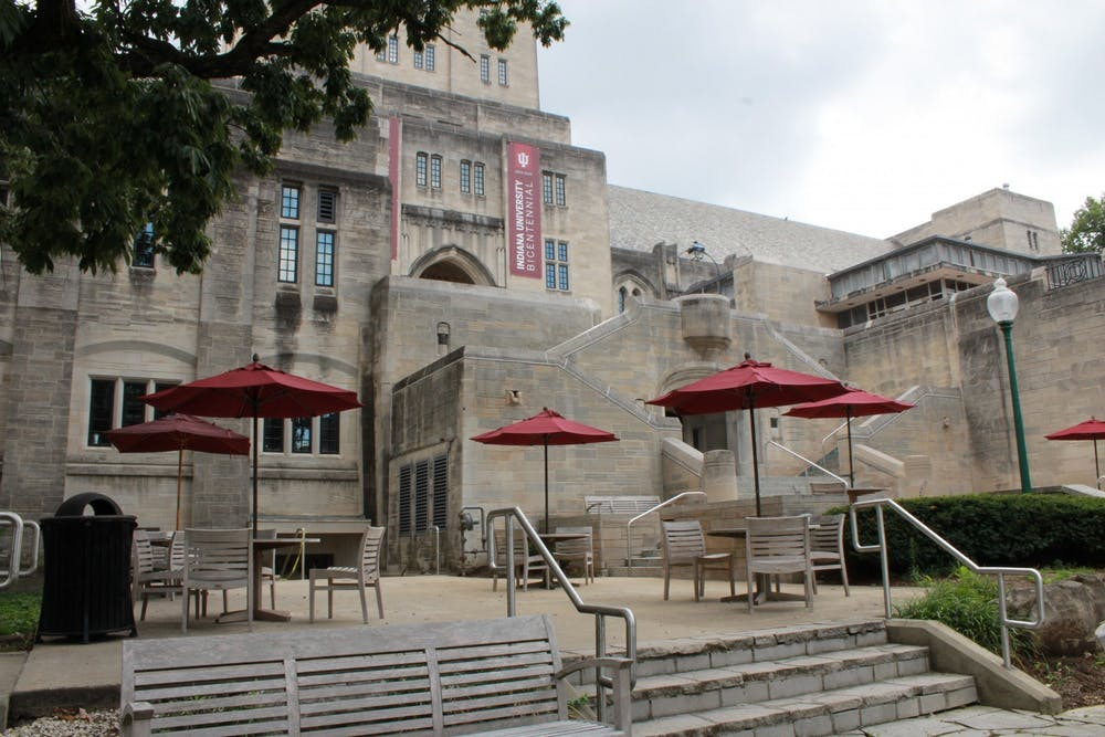 Tables and chairs sit Aug. 22 on the patio outside of the Indiana Memorial Union.