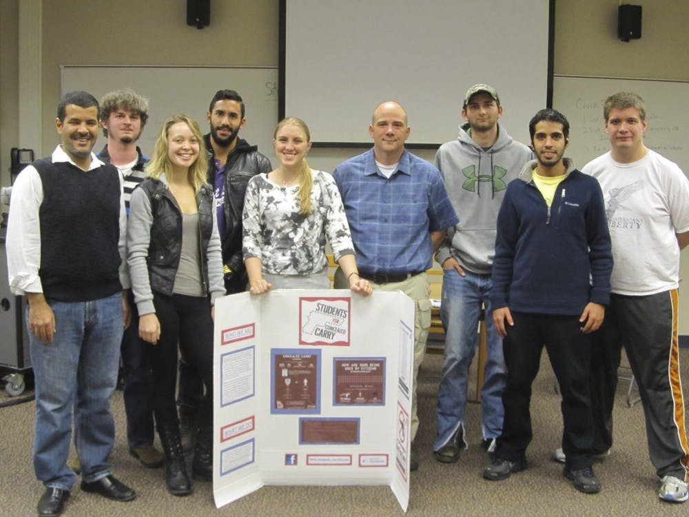 Students for Concealed Carry at IU Bloomington pose with advisor John Summerlot at a meeting. The group's next event is the National Empty Holster Protest on March 30, according to the Facebook page.
