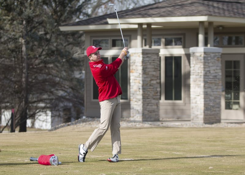 Then-freshman Evan Yakubov practices his iron shots during a practice at the IU Golf Course in Jan. 2018. The Hoosiers will compete in the Windon Memorial this weekend.