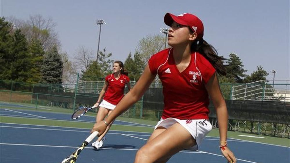 Sophomore Kayla Fujimoto (front) and senior Evgeniya Vertesheva prepare to return the ball in doubles play against the Minnesota Gophers on April 10 at the Indiana University Tennis Center. Fujimoto competed in the ITA Summer Circuit regional competition the weekend of July 30 at IU.