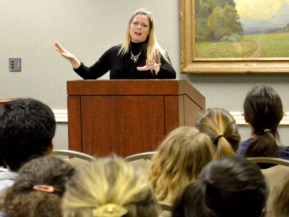 "Jennifer Thurma, director of Victim Services for the Indiana Attorney General, speaks about the sources and statistics behind human trafficking Tuesday at State Room East in the Indiana Memorial Union. ""The Hidden Reality: An Interactive Program on Human Trafficking"" included an interactive process that led participants through various countries where human trafficking occurs."