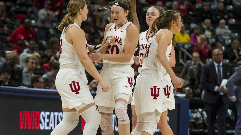 IU players celebrate after a play March 6 at Bankers Life Fieldhouse in Indianapolis. No. 4 seed IU defeated No. 5 seed Rutgers 78-60 in the quarterfinal round of the Big Ten Tournament.