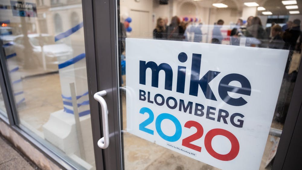 A campaign sign for presidential candidate Mike Bloomberg hangs in a doorway.