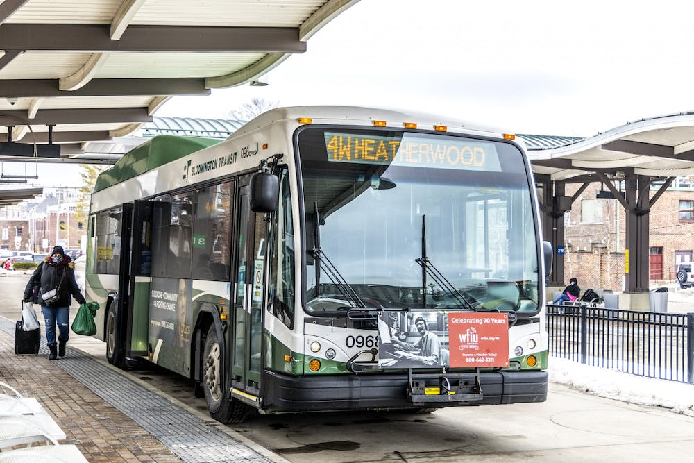 <p>A woman boards a bus Feb. 22 at the Bloomington Transit Center. The Bloomington Transit Board of Directors will discuss possible changes to routes March 16.<br/><br/></p>