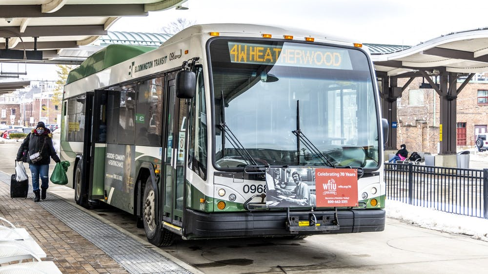 A woman boards a bus Feb. 22 at the Bloomington Transit Center. The Bloomington Transit Board of Directors will discuss possible changes to routes March 16.