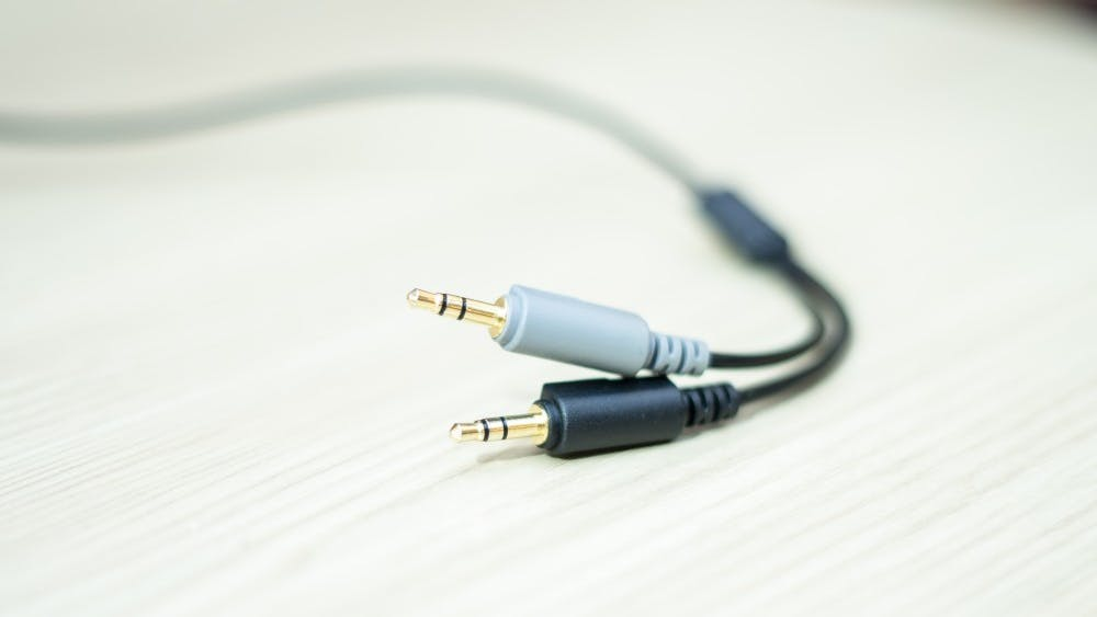 An aux cord sits Oct. 22 in Franklin Hall. Fighting to keep the aux cord can be a struggle when hanging out with your friends.