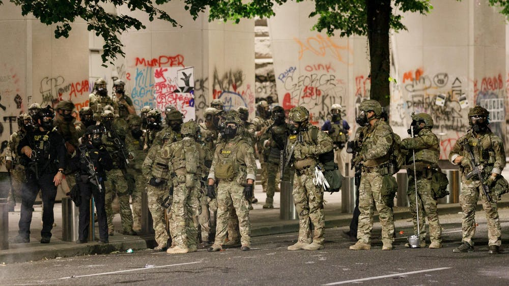 """Protesters demonstrate against police brutality for the 50th day in a row on July 16, 2020, at the Federal Courthouse in Portland, Oregon, and are met with tear gas, """"less-lethal"""" munitions and many arrests."""