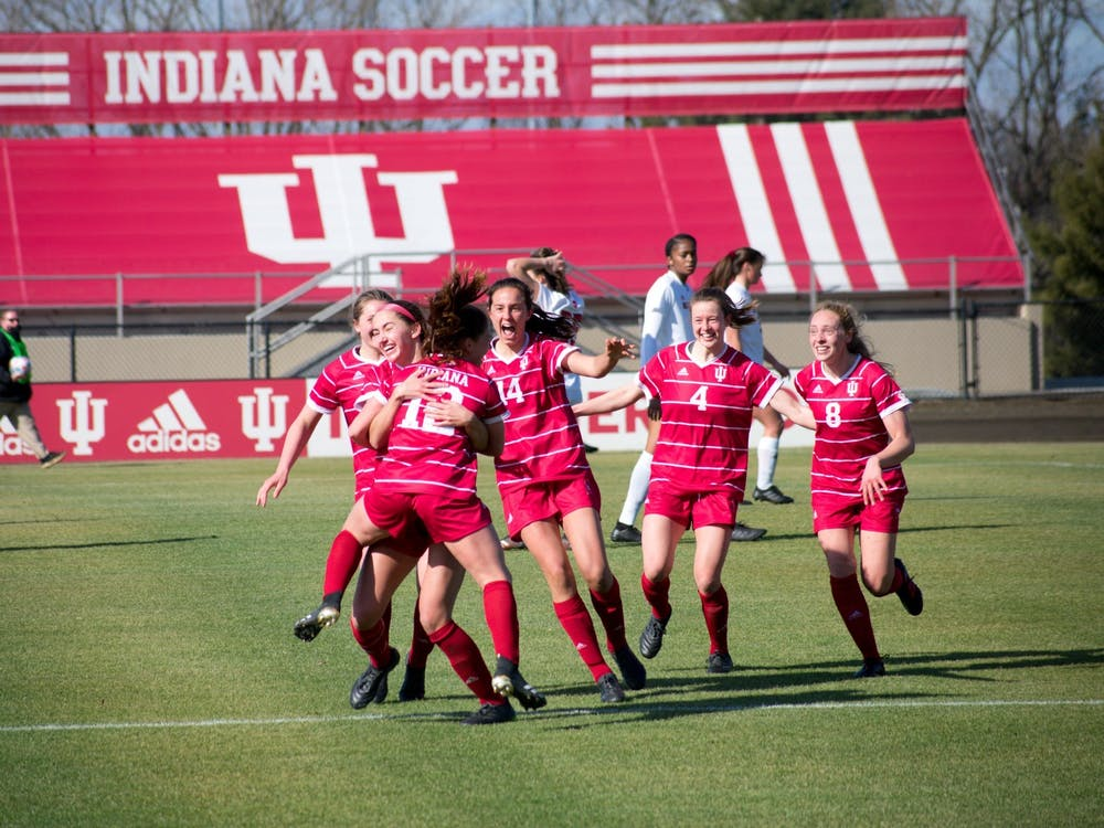 IU women's soccer athletes celebrate Feb. 25 at Bill Armstrong Stadium. The Hoosiers lost 0-2 to the Ohio State Buckeyes on Thursday.