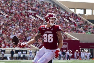 Sophomore tight end Peyton Hendershot looks back at his team after scoring a touchdown Sept. 21 at Memorial Stadium. IU led against University of Connecticut at halftime, 17-3.