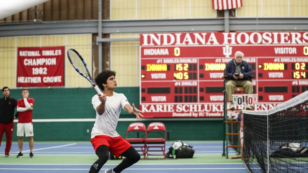 Freshman Vikash Singh plays against the University of Central Florida on Feb. 8 at the IU Tennis Center. Singh grew up playing tennis down the street from his home in Koppal, India.