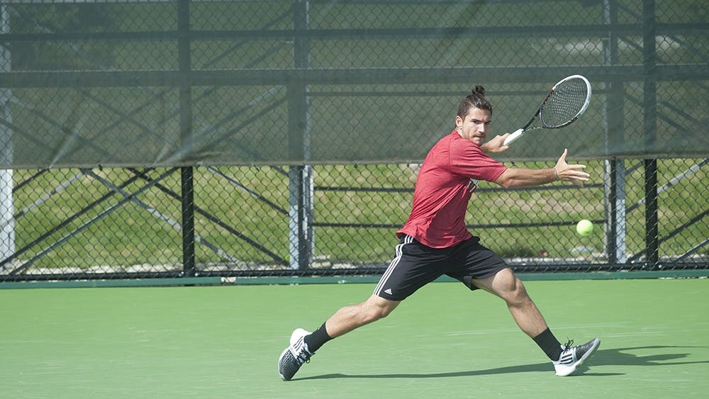 IU Junior Sam Monette hitting a forehand shot against Matt Hagan of the University of Iowa on Apr. 5 at the Varsity Tennis Courts. Monette edged his opponent and won the match 7-6, 7-6.