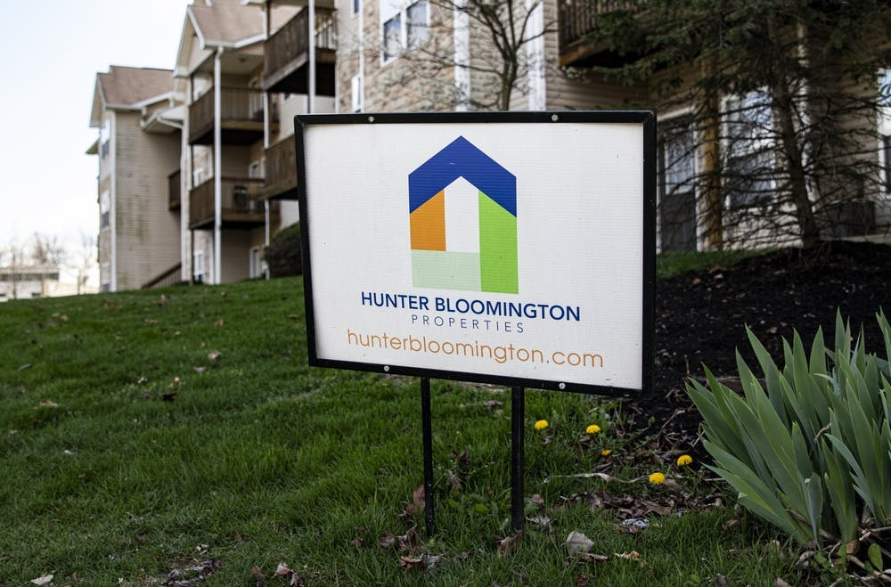 <p>A Hunter Bloomington Properties sign stands in the grass April 6 outside Bloom Apartments. </p>