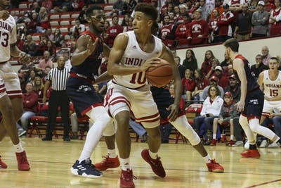 Freshman guard Rob Phinisee guards the ball against junior University of Southern Indiana guard Kourtlandt Martin on Nov. 1 in Simon Skjodt Assembly Hall. IU plays No. 24 Marquette on Wednesday night.