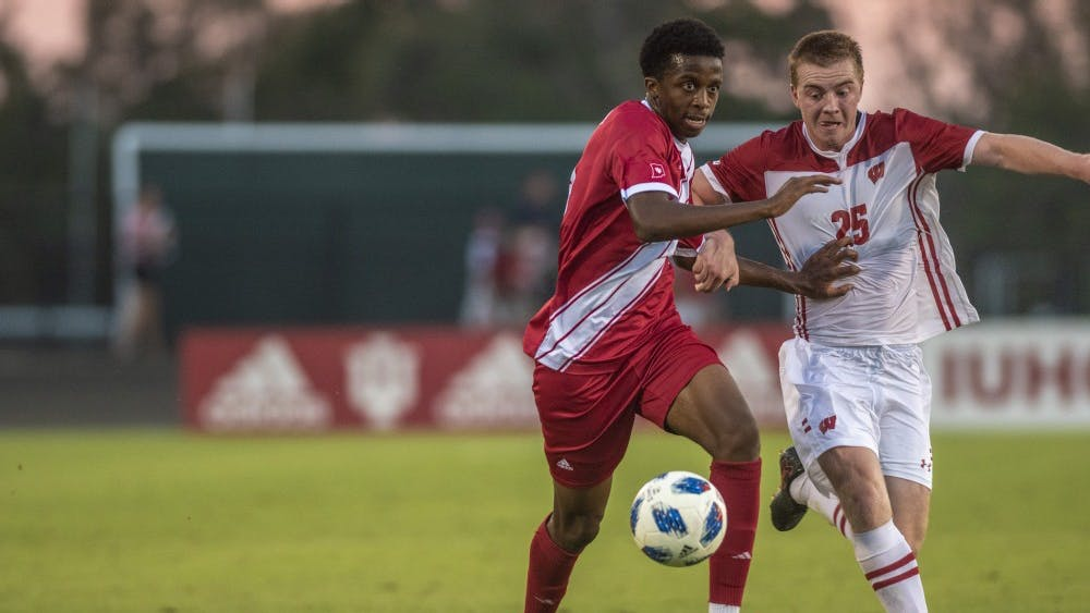 Freshman Maouloune Goumballe dribbles past Wisconsin junior Ben Leas in the dying moments of the game Sept. 20 at Bill Armstrong Stadium. Goumballe put the ball in at the far post to give IU a 3-1 lead over Wisconsin.