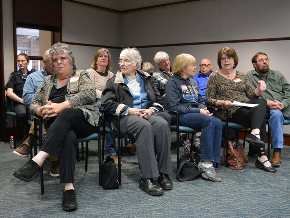 Residents of Edgewood Hills, part of the second annexation area, wait for the city council meeting to start Wednesday night. Many people who live outside city limits hope to stop the annexation.