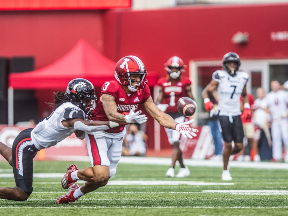 Senior wide reciever Ty Fryfogle attempts to dive for the catch Sept. 18, 2021, during the game against the University of Cincinnati at Memorial Stadium. Indiana's record is 1-2 after losing to Cincinnati.