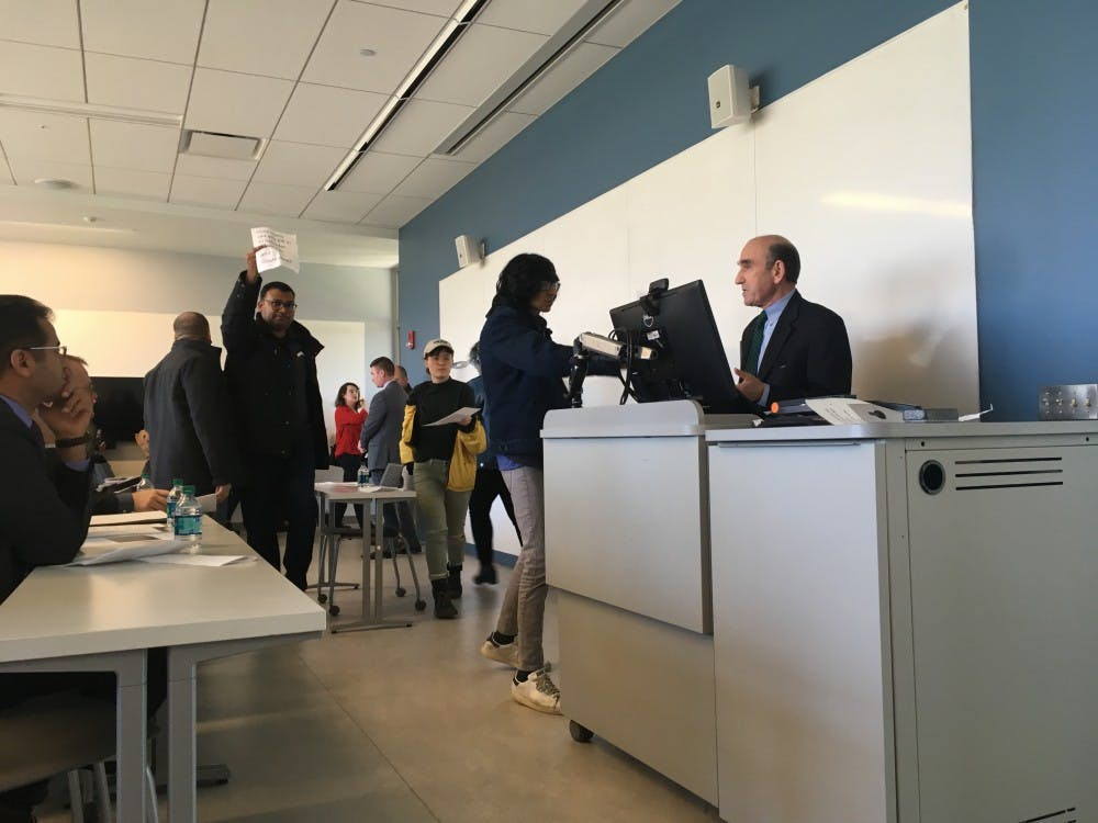 Students drop fliers as they leave Elliott Abrams' speech. The event was organized March 2, 2018, and drew heavy controversy.