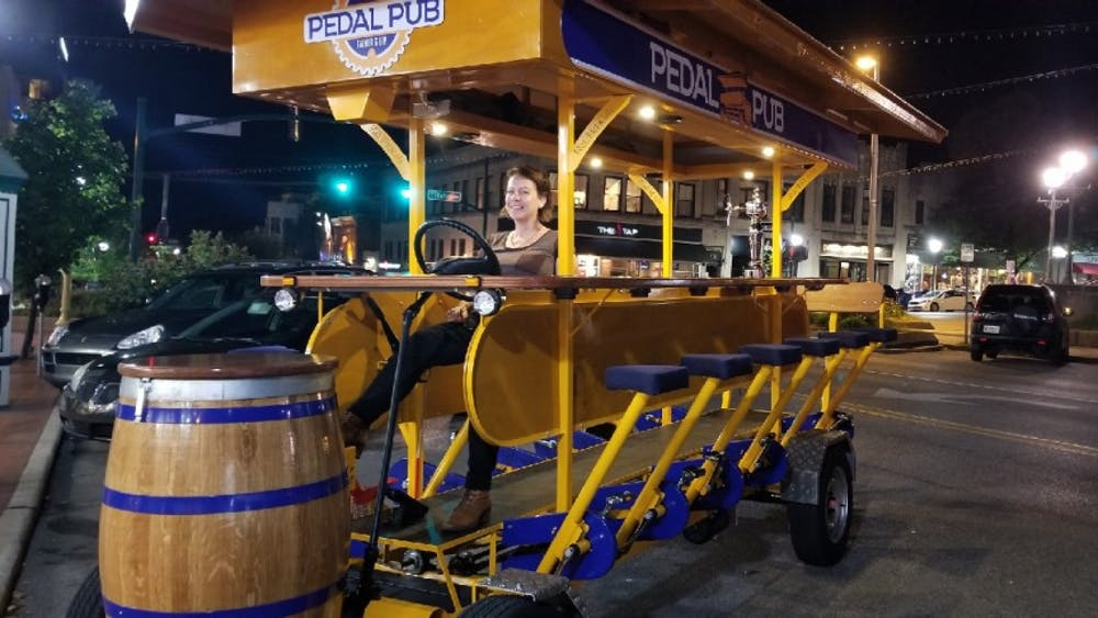 Pictured is the Pedal Pub parked in downtown Bloomington.