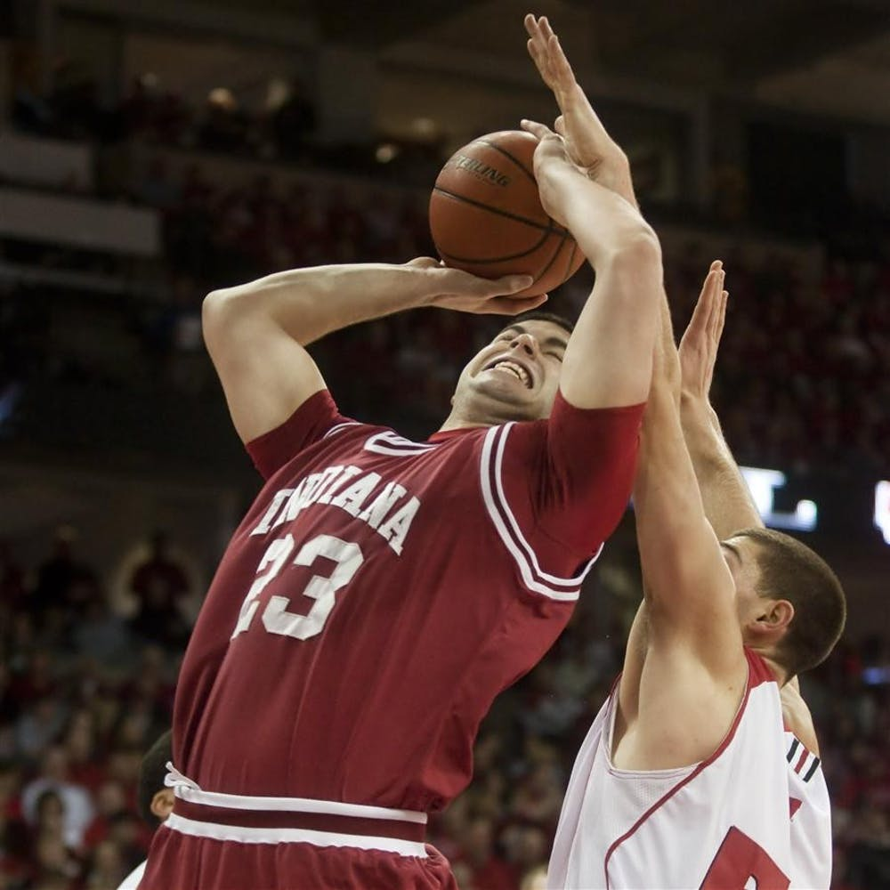 Freshman forward Bobby Capobianco attempts a layup during IU's 83-55 loss to Wisconsin Feb. 13 at the Kohl Center in Madison, Wisc.