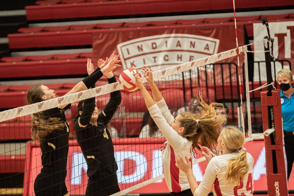 <p>Sophomore setter Emily Fitzner and freshman middle blocker Leyla Blackwell go up for a block against Purdue on Feb. 23 at Wilkinson Hall. IU fell 3-0 to No. 11 Purdue on Sunday in West Lafayette, Indiana.</p>