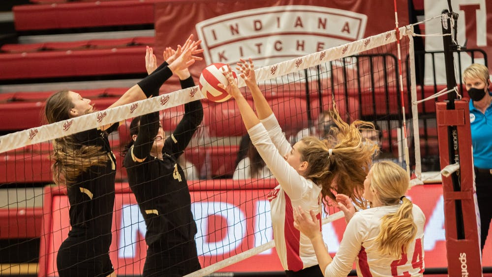Sophomore setter Emily Fitzner and freshman middle blocker Leyla Blackwell go up for a block against Purdue on Feb. 23 at Wilkinson Hall. IU fell 3-0 to No. 11 Purdue on Sunday in West Lafayette, Indiana.