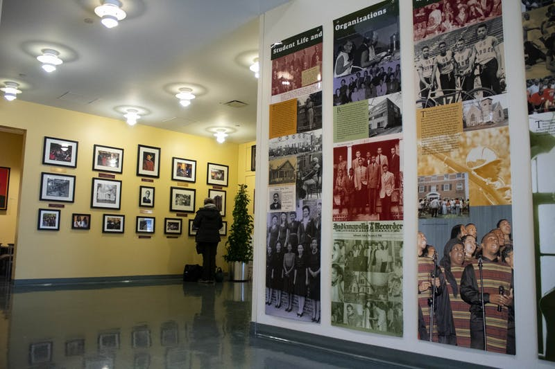 Students walk by the photographs on the walls Jan. 29, 2019, in the lobby of the Neal-Marshall Black Culture Center. The culture center will present the annual Umoja celebration virtually from Sunday to Friday.