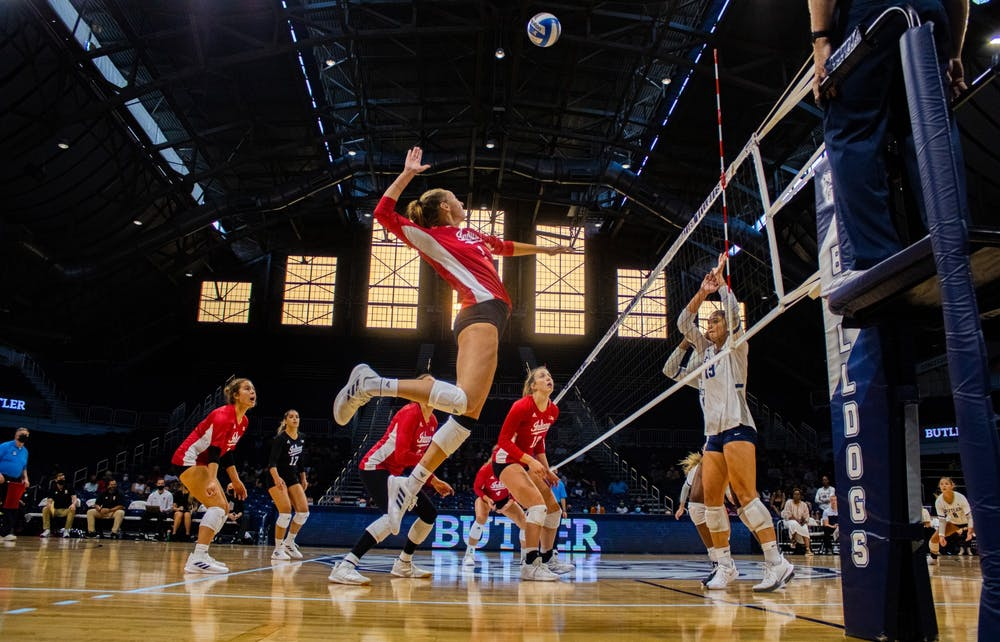 <p>Senior Kari Zumach goes for a spike in the game against Butler University on Aug. 28, 2021, at Hinkle Fieldhouse in Indianapolis. Indiana won two of its three games at the Discover Kalamazoo Classic.</p>