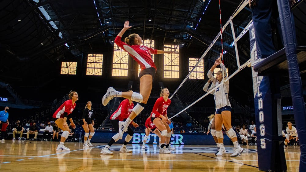 Senior Kari Zumach goes for a spike in the game against Butler University on Aug. 28, 2021, at Hinkle Fieldhouse in Indianapolis. Indiana won two of its three games at the Discover Kalamazoo Classic.