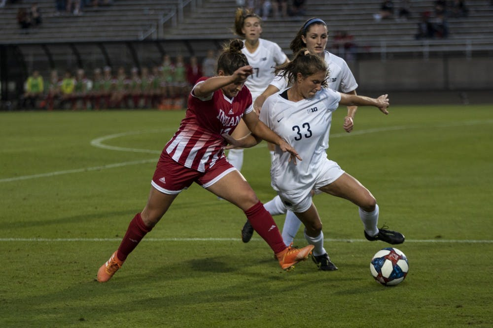 <p>Junior Melanie Forbes fights for the ball against Penn State senior Laura Suero on Oct. 10 at Bill Armstong Stadium. Forbes shot 4 of the 7 IU attempts at goal in the loss against Penn State. </p>