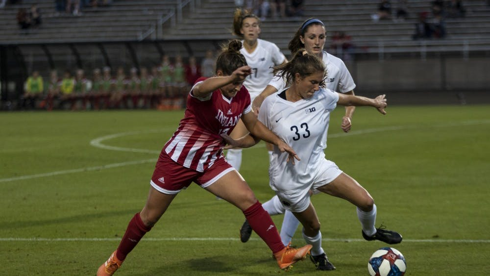Junior Melanie Forbes fights for the ball against Penn State senior Laura Suero on Oct. 10 at Bill Armstong Stadium. Forbes shot 4 of the 7 IU attempts at goal in the loss against Penn State.
