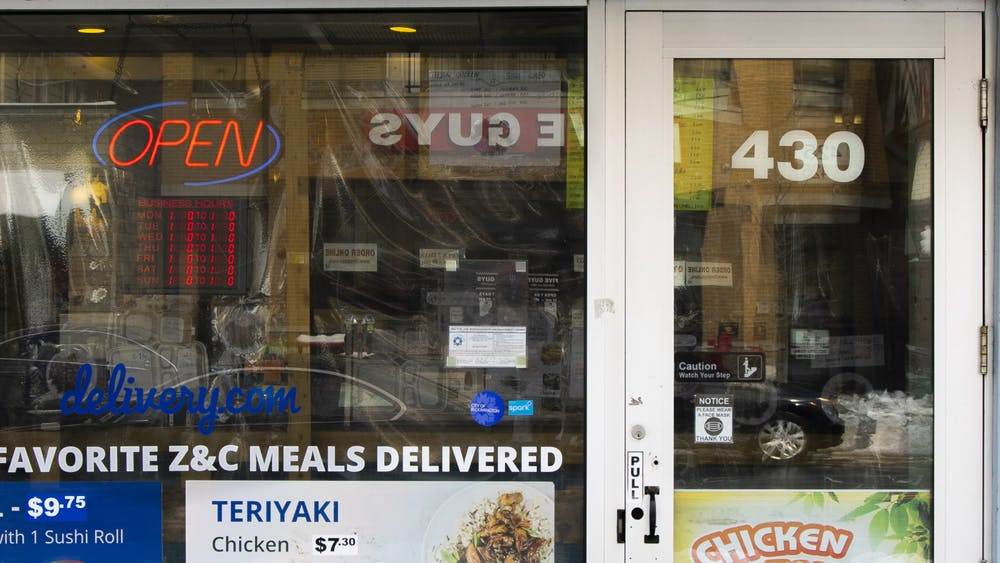An open sign is seen Wednesday in the storefront of Z&C Teriyaki and Sushi Restaurant on Kirkwood Avenue. The Indiana State Senate passed a bill Feb. 8 that will allow small businesses to appeal to COVID-19 shutdowns.