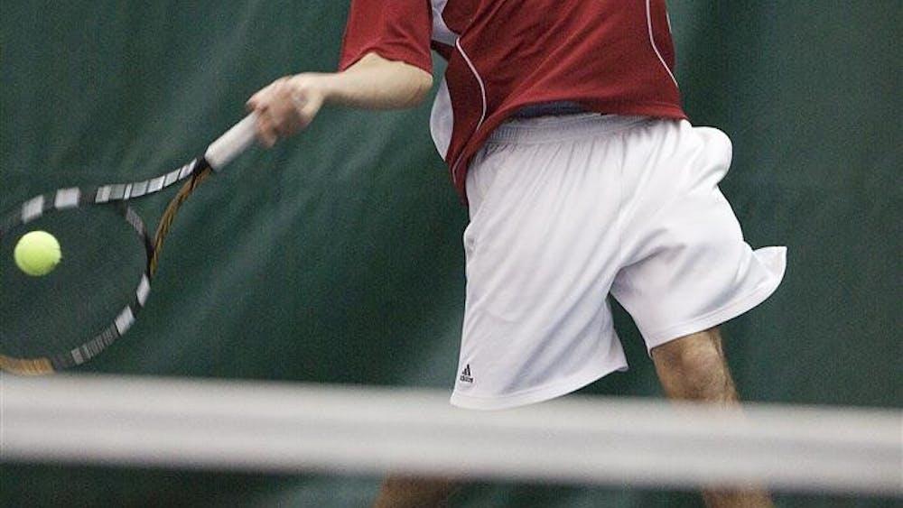Sophomore Stephen Vogl returns a shot against Butler on Saturday at the IU Tennis Center.