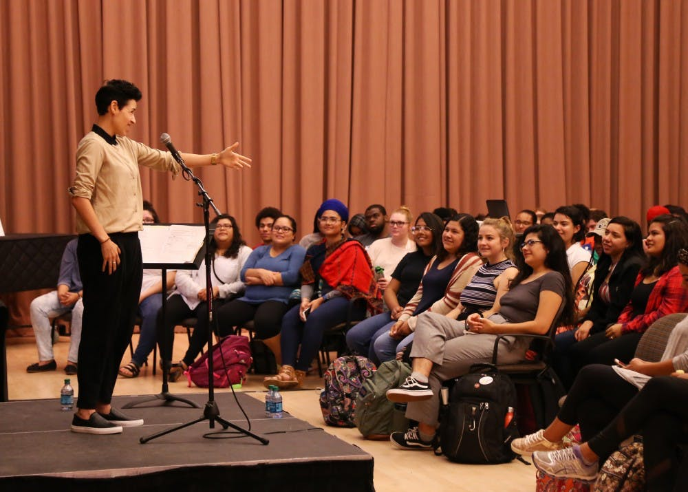 <p>Denice Frohman reads her poem in Neal-Marshall Hall Wednesday night. Forhman is an award-winning poet, writer, performer and educator whose work explores the intersections of race, ethnicity, gender and sexuality.&nbsp;</p>