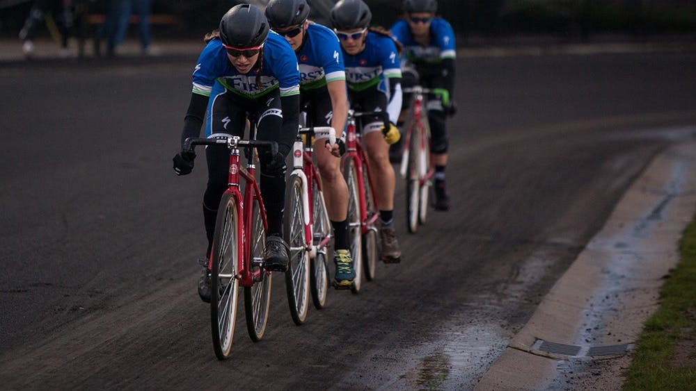 Teter Cycling rides through turn four at Bill Armstrong Stadium on Sunday during Team Pursuit.