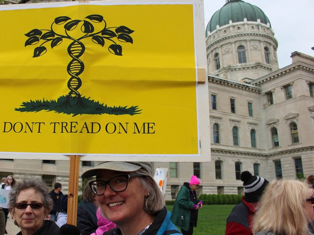 Tami Coleman, 54, came to join an estimated 10,000 people at the March for Science in Indianapolis from her hometown, Anderson, Indiana. Coleman said she's a New Englander, and is sick of pepole co-opting New England symbols, like the Gasden flag, to further their causes.