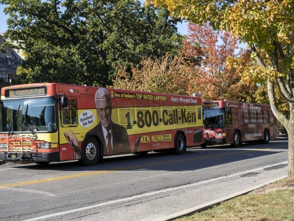 Two Bloomington Transit buses wait to pick up students Oct. 15, 2019, on Seventh Street. The Bloomington Transit Board of Directors will discuss possible changes to routes March 16.