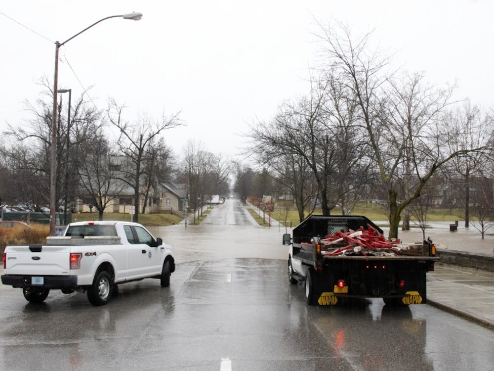 The Jordan River overflows onto Indiana Avenue on Feb. 7 behind Franklin Hall. The street was blocked off due to flooding.