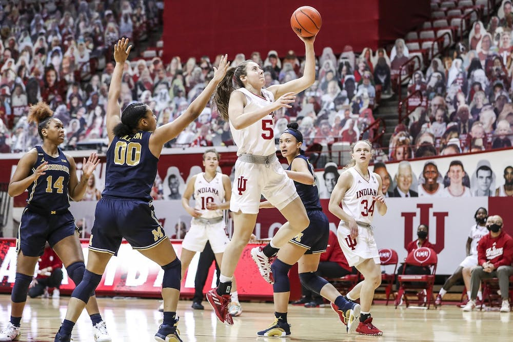 <p>Sophomore forward Mackenzie Holmes goes for a shot Feb. 18 at Simon Skjodt Assembly Hall. The Hoosiers lost 53-66 to the Arizona Wildcats on Monday in San Antonio, Texas. </p>