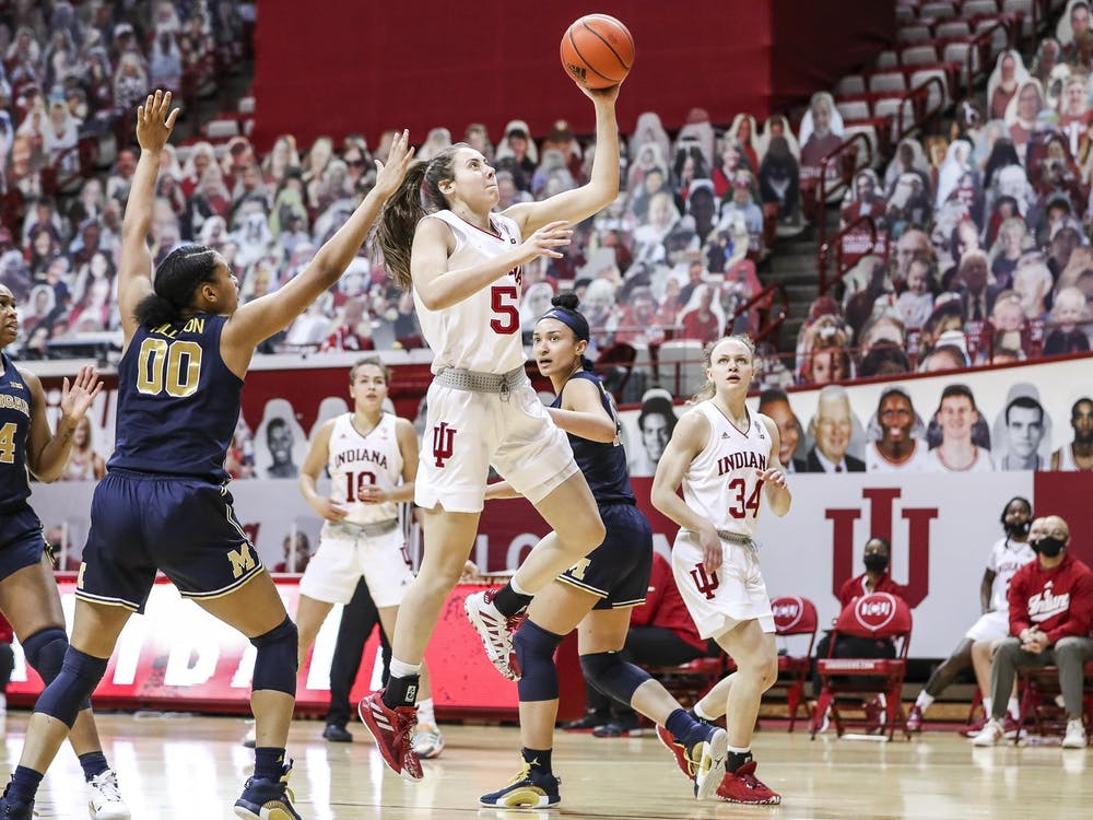 Sophomore forward Mackenzie Holmes goes for a shot Feb. 18 at Simon Skjodt Assembly Hall. The Hoosiers lost 53-66 to the Arizona Wildcats on Monday in San Antonio, Texas.