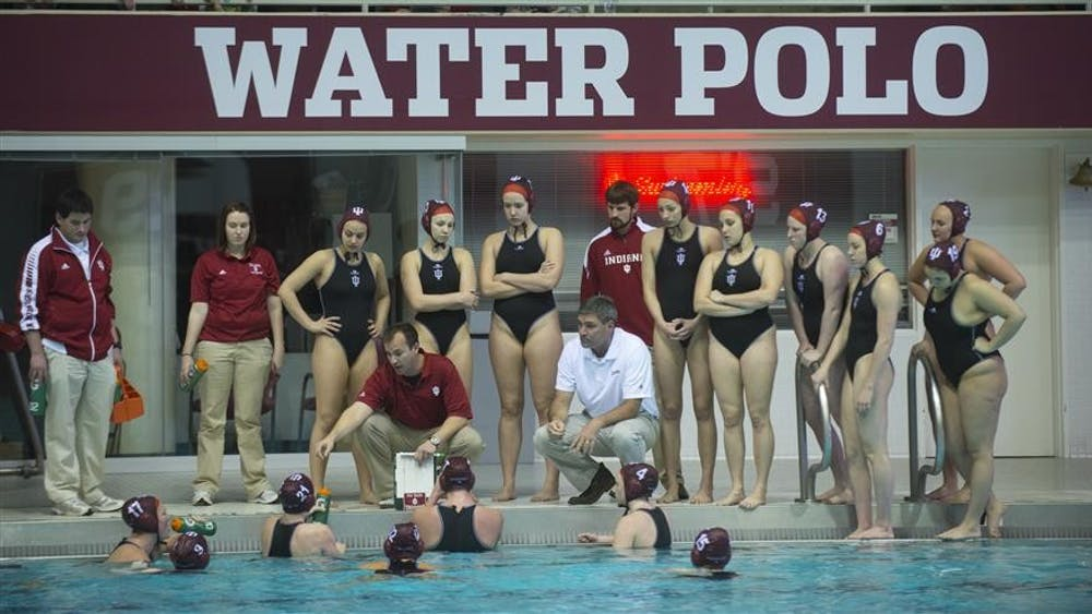 The IU Women's Water Polo team meets poolside during their game against Long Beach State on Feb. 23, 2013 at the Counsilman-Billingsly Aquatic Center.