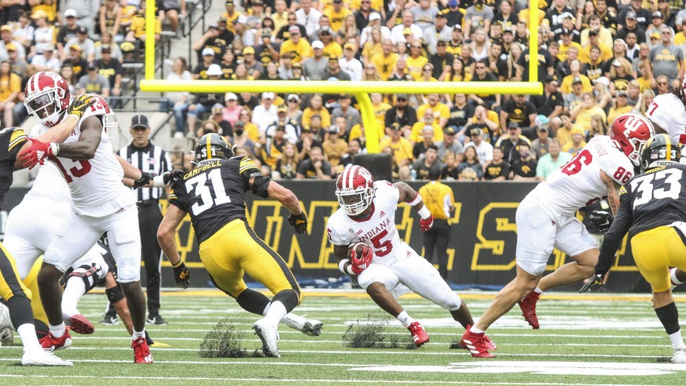 Graduate student running back Stephen Carr runs with the ball druing the game against the University of Iowa Sept. 4, 2021, in Kinnick Stadium in Iowa City, Iowa. Indiana will play the University of Idaho for the first time Sept. 11, 2021, in Bloomington.
