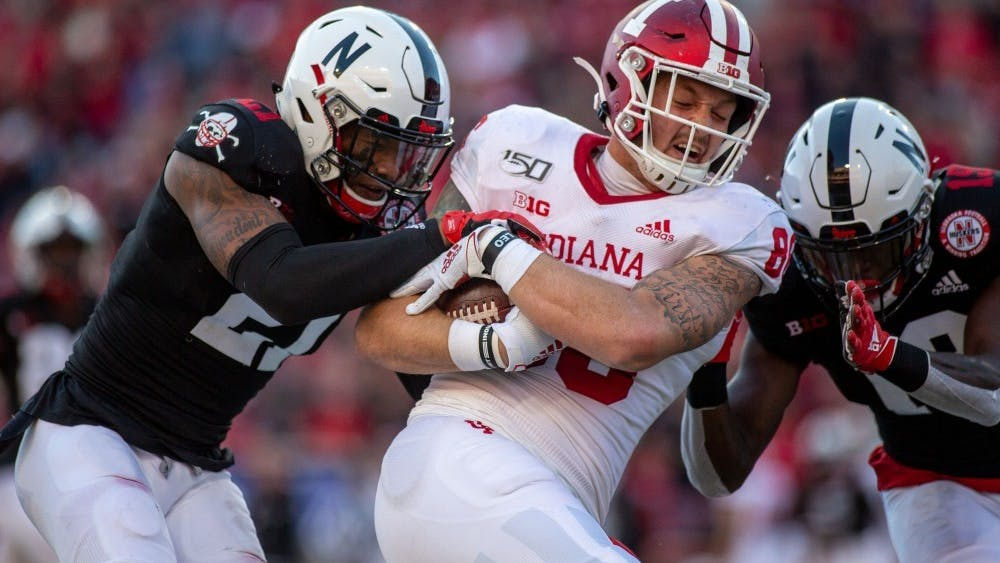 Junior tight end Peyton Hendershot runs with the ball after a reception Oct. 26, 2019, at Memorial Stadium in Lincoln, Nebraska. Hendershot, who apologized Oct. 9 for a February arrest on four misdemeanor charges, including domestic battery and criminal trespass, has struggled to find consistency in the IU offense.