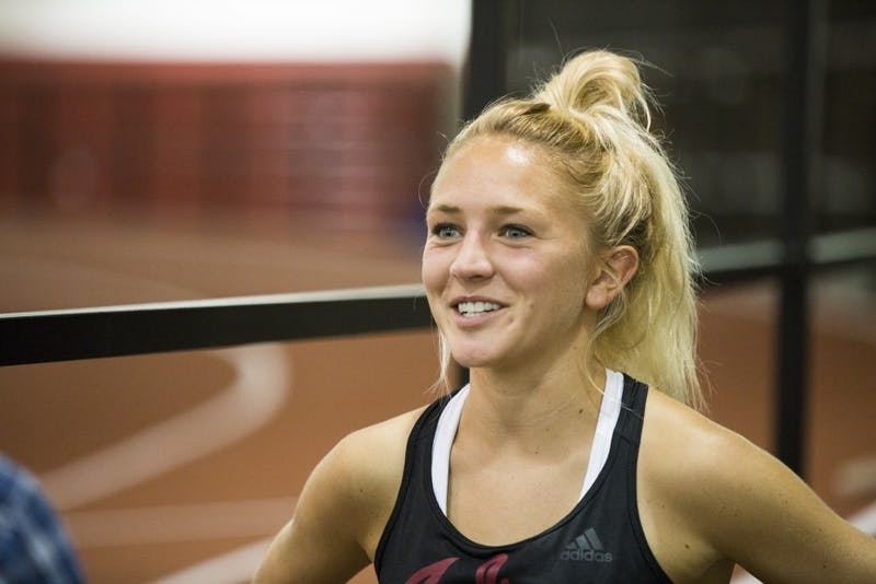 Senior Katherine Receveur smiles while talking about sophomore Lexa Barrott on Friday afternoon in Gladstein Fieldhouse. Receveur finished first at the Iona Meet of Champions on Sept. 14.