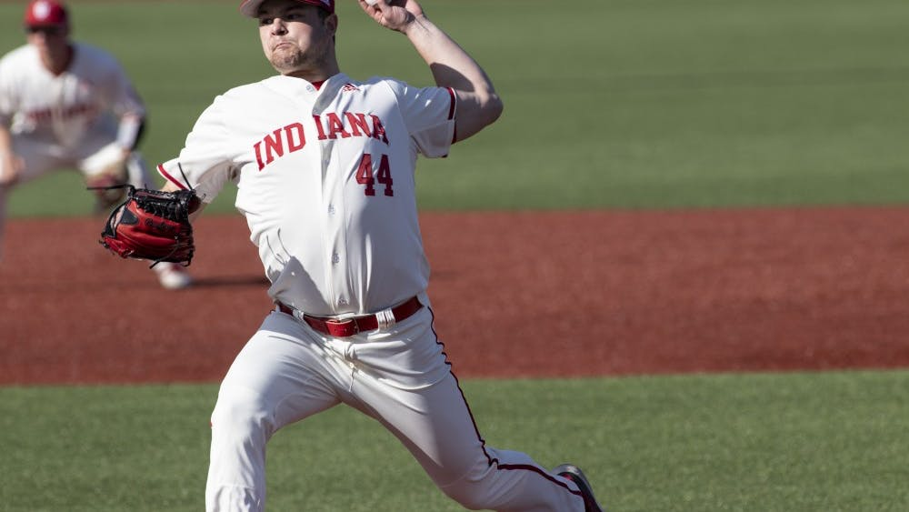 Junior left-handed pitcher Cam Beauchamp sends the ball to the plate March 27 at Bart Kaufman Field. IU will play the University of Maryland on March 29-31.