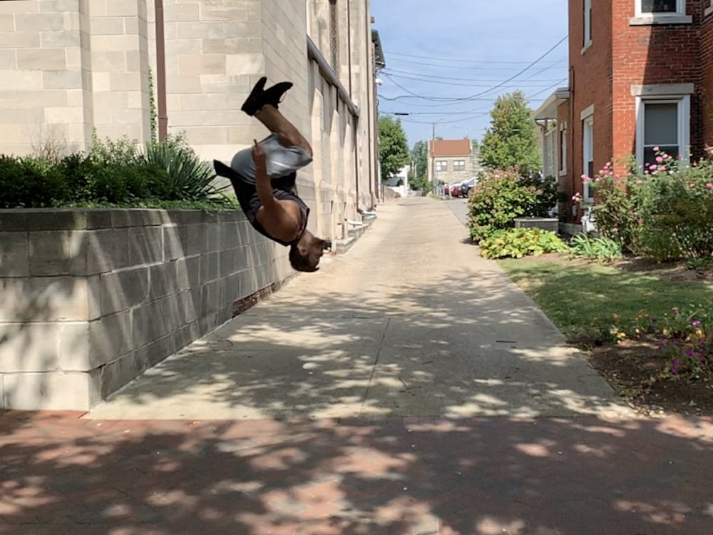 Parkour instructor James Brown demonstrates his backflip off of a wall Sept. 22 outside of the First Christian Church. This was the second parkour meeting Brown led.